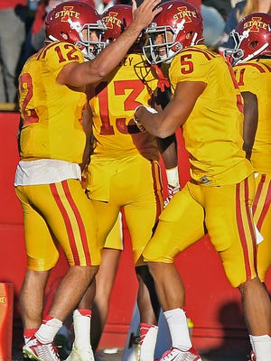 After scoring a touchdown against Toledo, Iowa State's Allen Lazard, right, gets a pat on the helmet from quarterback Sam Richardson.