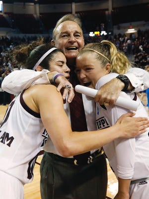 Mississippi State guard Dominique Dillingham, left, and teammate Blair Schaefer are hugged by their coach Vic Schaefer following their second-round win over DePaul, 92-71, in the women's NCAA college basketball tournament in Starkville, Miss., Sunday, March 19, 2017.