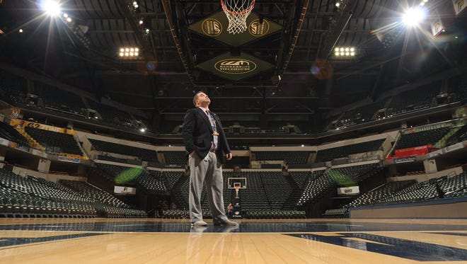 Pennfield graduate Steve Miknis stands on the court at Bankers Life Fieldhouse, home of the Indiana Pacers.