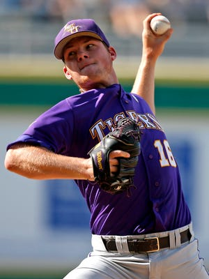 LSU's Jared Poche' (16) pitches during the third inning against Rice in an NCAA college baseball tournament regional game in Baton Rouge, La., Tuesday, June 7, 2016. (AP Photo/Gerald Herbert)