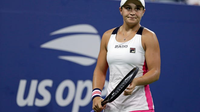 FILE - In this Sept. 7, 2019, file photo, Bianca Andreescu, of Canada, holds up the championship trophy after defeating Serena Williams, of the United States, in the women's singles final of the U.S. Open tennis championships in New York. The U.S. Tennis Association intends to hold the U.S. Open Grand Slam tournament in New York starting in August without spectators, if it gets governmental support -- and a formal announcement could come this week.