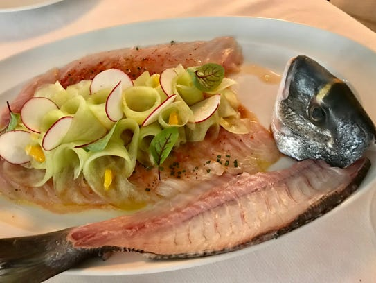 Grecian dorade in a dish of whole-fish crudo from Sails