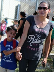 Kindergartener Jacob Gonzales is all smiles as his mother Elena Gonzales picks him up from Vista Del Monte Elementary School in Palm Springs on Monday.