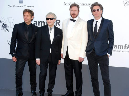 Duran Duran, from left, Roger Taylor, Nick Rhodes, Simon Le Bon and John Taylor arrive at the 2013 amfAR Cinema Against AIDS benefit during the 66th international film festival, in Cap d'Antibes,   France.