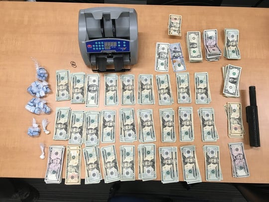 Cash and drugs police obtained during a search warrant on March 11.