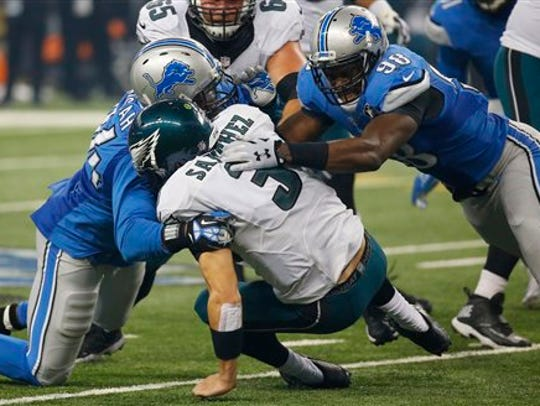 Ziggy Ansah, formerly of the Detroit Lions, sacks former Eagles quarterback Mark Sanchez during a game in 2015. Ansah, a free agent, has 48 sacks in his six-season career.