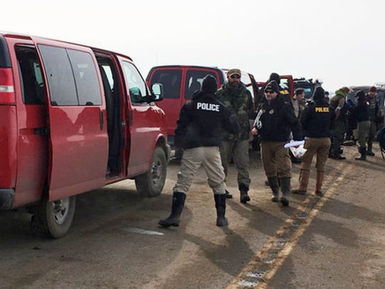 Authorities arrest the last remaining holdouts in the now-closed Dakota Access pipeline protest camp in southern North Dakota near Cannon Ball on Thursday, Feb. 23, 2017. Police made about several dozen arrests, and declared the camp cleared after about 3 1/2 hours.