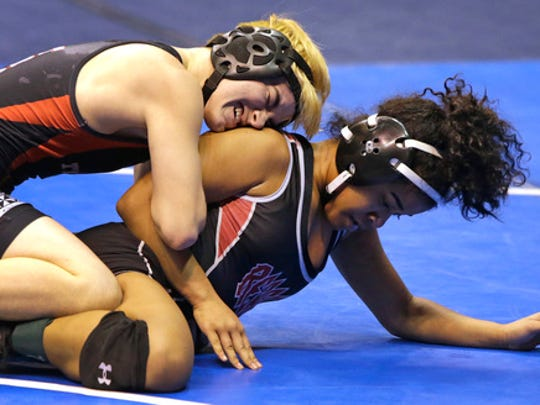 Mack Beggs, top, a transgender wrestler from Euless Trinity competes in a quarterfinal against Mya Engert of Amarillo Tascosa during the state wrestling tournament Friday, Feb. 24, 2017, in Cypress, Texas. Beggs was born a female and is transitioning to male but wrestles in the girls division.