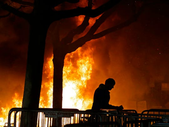 "FILE - In this Feb. 1, 2017 file photo, a fire set by demonstrators protesting a scheduled speaking appearance by Breitbart News editor Milo Yiannopoulos burns on Sproul Plaza on the University of California, Berkeley campus. The campus is bracing for a showdown next week, when the conservative provocateur Ann Coulter has vowed to speak in defiance of the university's wishes. Officials, police and the campus Republicans who invited Coulter, say there are valid concerns for violence in what is being called an ongoing ""Battle of Berkeley."""