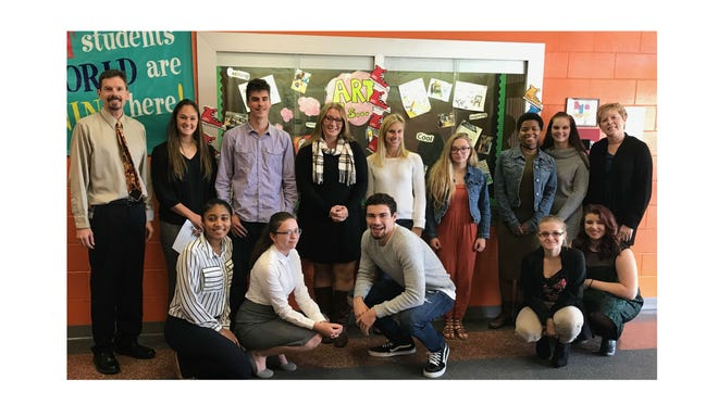 (Kneeling, from left) Taelyn Williams, Sienna Brown, William Hawkins, Emily Bramante and Christen Wilson; and (standing, from left), Janvier Principal Henry Kobik, Cassidy MeErlain, Jake Carlson, Paige Starr, Carley Epley, Lena Viti. Allyiah Merritt, Courtney Moore and Delsea Regional High School teacher Kathy Assini, are pictured during a visit by Delsea's Tomorrow's Teachers to Janvier Elementary School in Franklin Township.