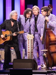 Marty Stuart, left, performs at the Grand Ole Opry with his band, the Fabulous Superlatives.