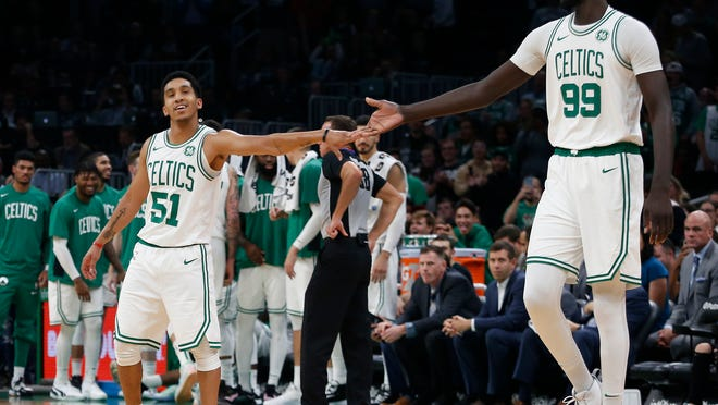 Guard Tremont Waters, left, and center Tacko Fall, right, will return to the Celtics on two-way contracts, meaning they can split their time between Boston and the Maine Red Claws.