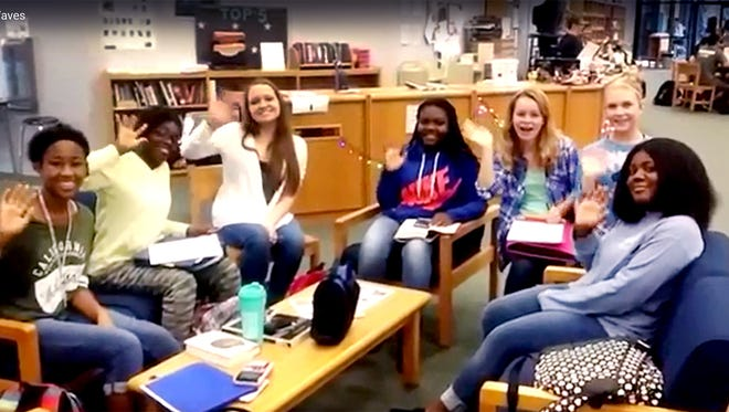 Blackman High School students appear in a video get-well greeting for Paul Tidwell, a terminally ill man who waves as passers-by daily.