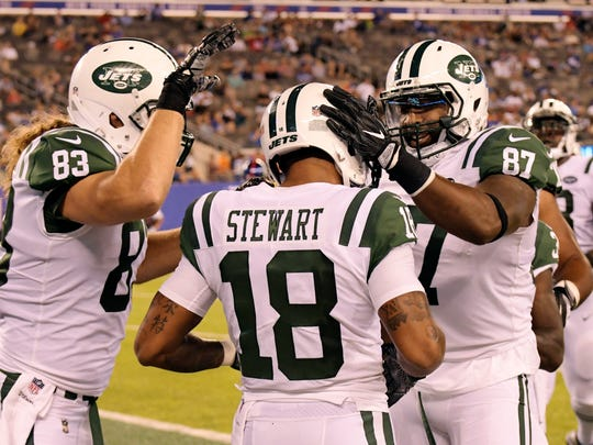 New York Jets' Chris Gragg (87) and Eric Tomlinson (83) celebrate with teammate ArDarius Stewart (18) after Stewart scored a touchdown during the second half of a preseason NFL football game against the New York Giants on Saturday, Aug. 26, 2017, in East Rutherford, N.J. (AP Photo/Bill Kostroun)
