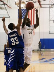 Anthony Wartley-Fritz (No. 24) of Schoolcraft's men's
