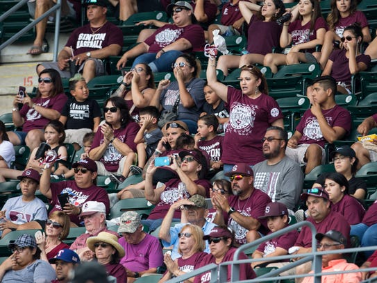 Sinton fans cheer in the stands for during the Class