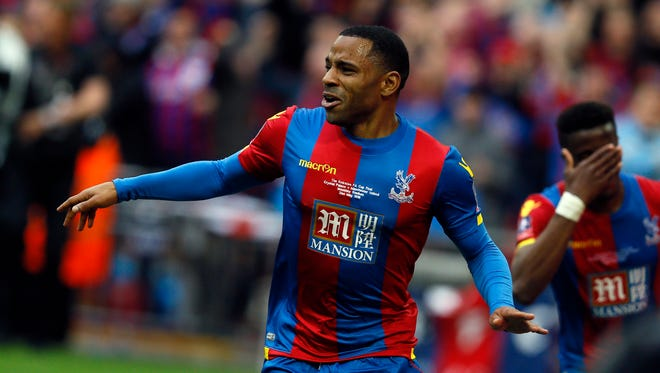 Crystal Palace''s Jason Puncheon (left) celebrates after scoring the opening goal during the English FA Cup final soccer match between Manchester United and Crystal Palace at Wembley Stadium in London on May 21.