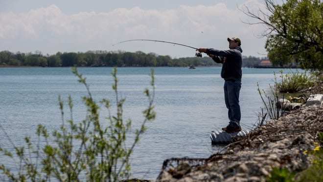 Chad Teltow, of Richmond, casts his line  on the St. Clair River  at Algonac State Park.