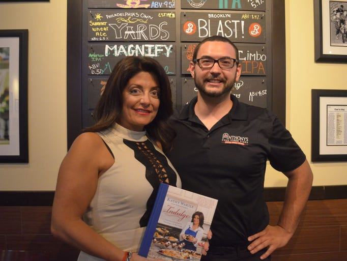 Kathy Wakile and manager of Anthony's Coal Fired Pizza