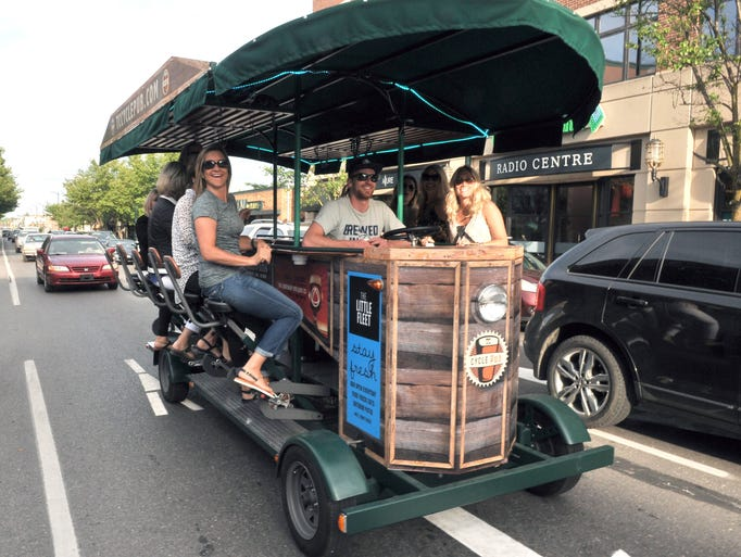 Levi Martin steers TC Cycle Pub's pedal-powered trolley