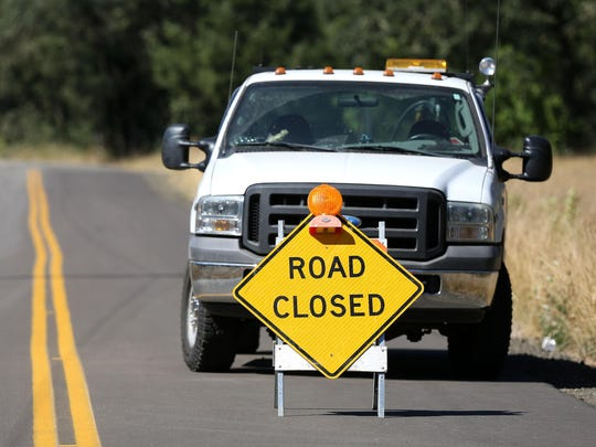 Willamina Creek Road is closed while firefighters battle a wildfire near Willamina.