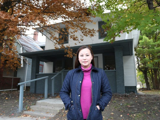 Clara Tan Lisin's Singapore development company has bought 85 houses in Indianapolis, including this one at 632 Eastern Ave., and aims to buy hundreds more. She's raising millions of dollars from Asian investors to fix up the houses and rent them to tenants.