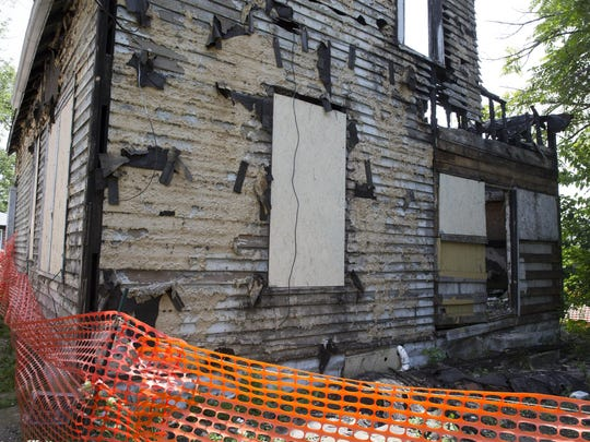 Taxpayers spent $7,850 demolishing this abandoned home, owned by Johnny Big Stuff LLC, Indianapolis, Tuesday Aug. 4, 2015.