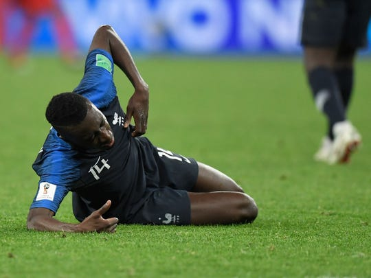 France's midfielder Blaise Matuidi reacts after a collision during the Russia 2018 World Cup semi-final football match between France and Belgium at the Saint Petersburg Stadium in Saint Petersburg on July 10, 2018. / AFP PHOTO / GABRIEL BOUYS / RESTRICTED TO EDITORIAL USE - NO MOBILE PUSH ALERTS/DOWNLOADS GABRIEL BOUYS/AFP/Getty Images ORIG FILE ID: AFP_17G4TR