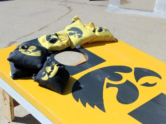 Iowa fans show their spirit before Saturday's game with a Hawkeye adorned bean bag toss.