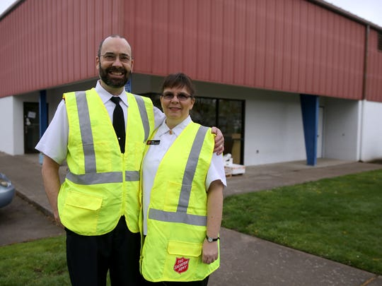 The Salvation Army's Major John and Candy Stennett volunteer at the organization's food pantry on Thursday, March 26, 2015, in Salem, Oregon.