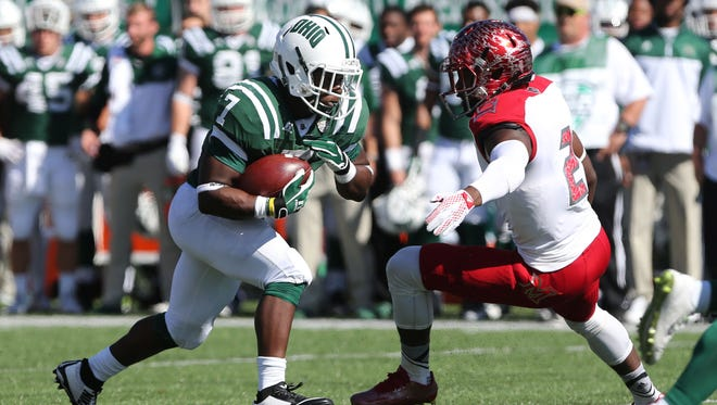 Ohio Bobcats running back Daz'mond Patterson (7) carries the ball as Miami RedHawks defensive back Joshua Allen (2) attempts to tackle him in the first half at Peden Stadium.