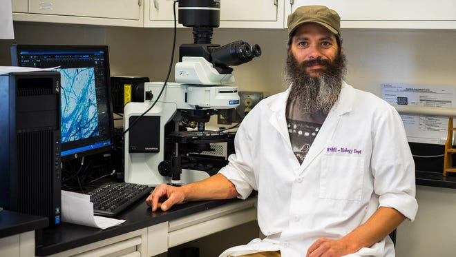 WNMU student Gabe Gilmore is in a science lab on the Western New Mexico University campus.