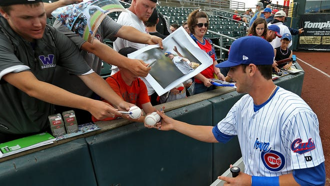 Recently promoted Iowa Cubs' third baseman Kris Bryant signed autographs for fans before game against the El Paso Chihuahuas at Principal Park in Des Moines on Wednesday night  June 19, 2014.