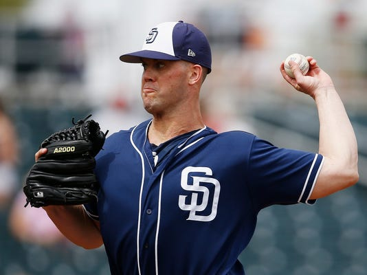 San Diego Padres starting pitcher Clayton Richard throws a pitch against the Cincinnati Reds during the first inning of a spring training baseball game Saturday, March 24, 2018, in Goodyear, Ariz. (AP Photo/Ross D. Franklin)
