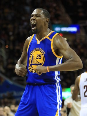 Warriors forward Kevin Durant reacts against the Cavaliers in Game 3 of the 2017 NBA Finals at Quicken Loans Arena on June 7, 2017 in Cleveland.