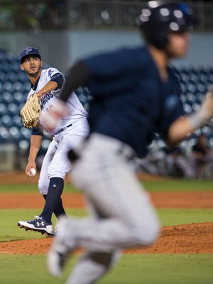 Starter Jose Lopez (19) gets set to throw to first for the out after a come-backer during the Mobile BayBears vs Pensacola Blue Wahoos baseball game in Pensacola on Monday, August 14, 2017.