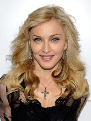 Singer Madonna arriving at Macy's Herald Square to launch her new fragrance in New York on April 12, 2012.