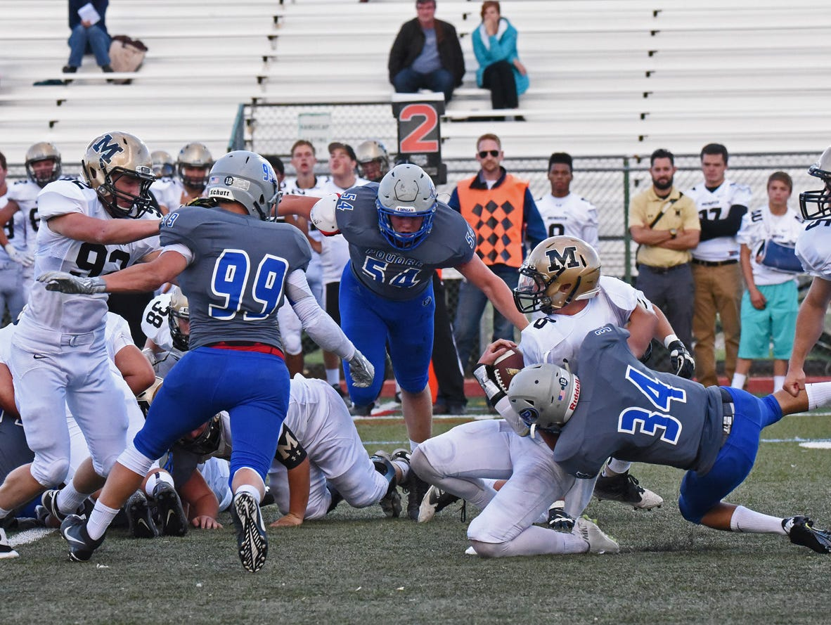 Poudre linebacker Aaron Diaz-Prieto makes a crushing tackle on Monarch quarterback Anthony Beck during first quarter action in their game Thursday evening.