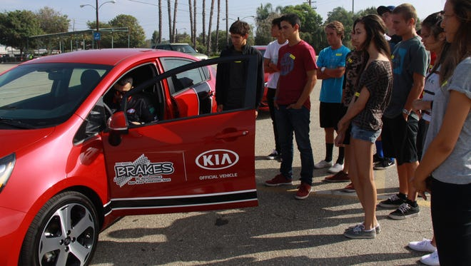 A Kia program that provides free hands-on-defensive driving for teens nationwide. (PRNewsFoto/Kia Motors America) ORG XMIT: PRN230371