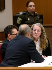 Amy Van Wagner (right) is shown before jury selection Tuesday in Waukesha County Court.