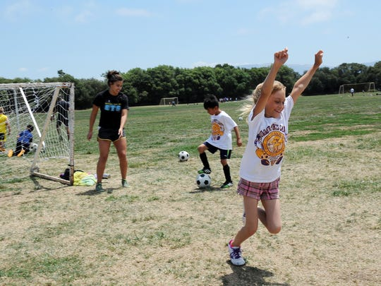 Scoring a goal brings out the joy in this young player at the annual summer soccer camp presented by the city of Salinas and Hartnell College.