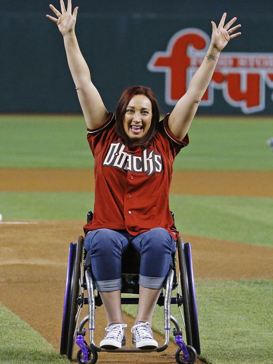 There's Amy: Van Dyken cheers after throwing out the