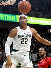 Spartans forward Miles Bridges (22) reacts after dunking the ball during the Big Ten basketball matchup between Rutgers and Michigan State at the Breslin Center Wed,  Jan. 4, 2017 in East Lansing.