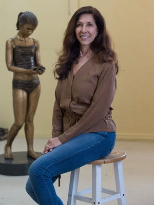 "Kristen Visbal in her studio in Lewes. Kristen created the acclaimed ""Fearless Girl"" statue across from the Wall Street Bull."