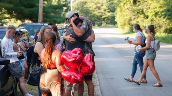 Friends and family gathered during a vigil service on Wednesday to honor the memories of four young adults killed in a car crash on George Flagg Parkway in Des Moines.