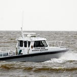 Search efforts continue for four people missing after a deadly weekend storm Monday, April 27, 2015, in Dauphin Island, Ala. As torrential rain and heavy winds battered Alabama's coast Monday, the U.S. Coast Guard suspended its search after a storm killed two people and played havoc with a yearly sailboat race in Mobile Bay. (Mike Kittrell/AL.com via AP) MAGS OUT; MANDATORY CREDIT