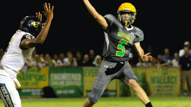 Catholic's Garrett Foley tosses a pass in the first half of the Crusaders' game against Gulf Breeze.