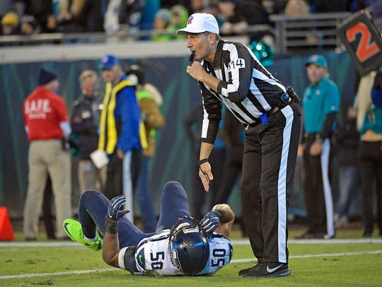 Referee Gene Steratore blows his whistle as he checks
