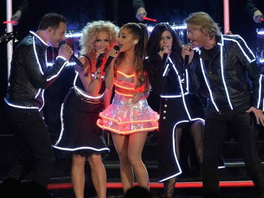 Jimi Westbrook and Kimberly Schlapman of Little Big Town, Ariana Grande, and Karen Fairchild and Phillip Sweet of Little Big Town perform during the 48th annual CMA Awards at the Bridgestone Arena on November 5, 2014 in Nashville, Tennessee.