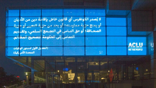 The ACLU of Michigan is displaying the First Amendment in English, Arabic and Spanish on billboards across the state. Here, it is in Arabic on a digital billboard on Cobo Hall.